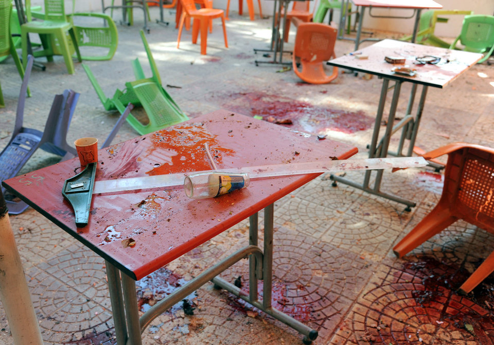 Photo - In this photo released by the Syrian official news agency SANA, plastic tables and chairs turned upside down, are seen on the floor of the open-air cafeteria at Damascus University in the central Baramkeh district, in Damascus, Syria, Thursday, March 28, 2013. Mortar shells slammed into a cafeteria at Damascus University, killing several people and wounding scores, according to state media and an official. It was the deadliest in a string of such attacks on President Bashar Assad's seat of power, state media and an official said. (AP Photo/SANA)