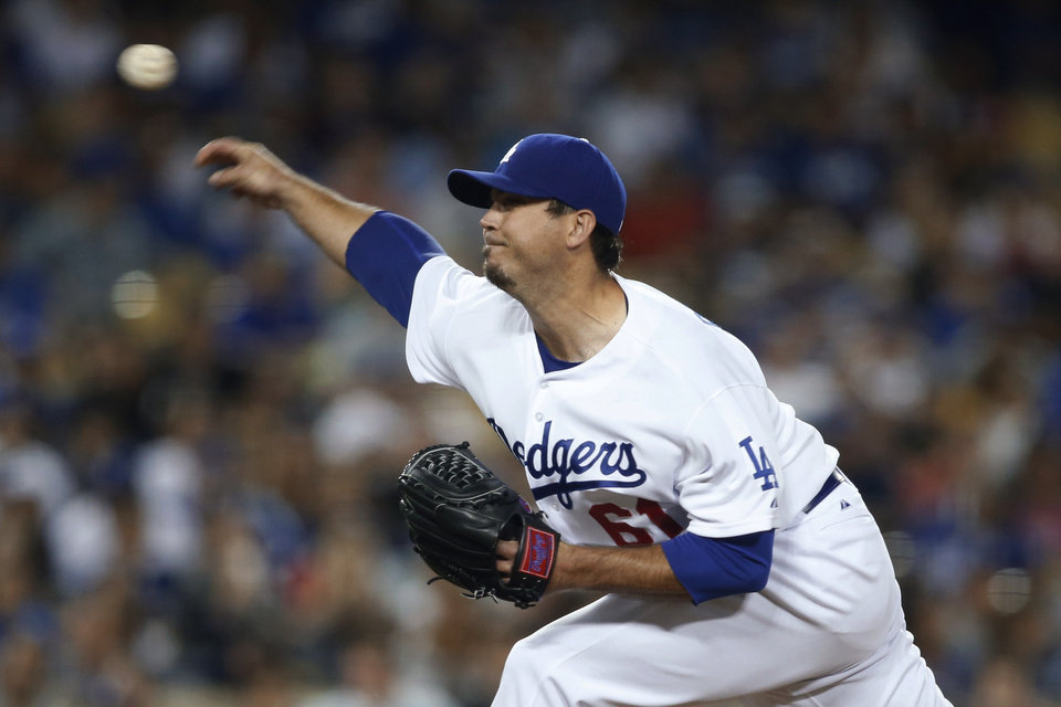 Photo - Los Angeles Dodgers' starting pitcher Josh Beckett delivers against the St. Louis Cardinals during the sixth inning of a baseball game, Thursday, June 26, 2014, in Los Angeles. (AP Photo/Danny Moloshok)