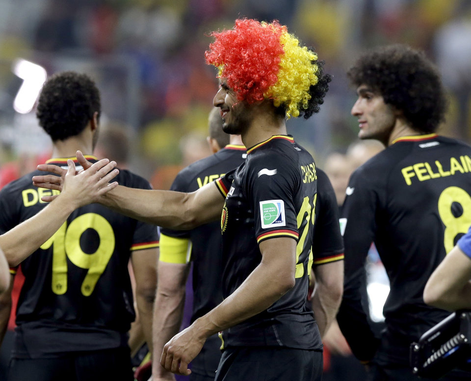 Photo - Belgium's Nacer Chadli, left, is congratulated by a teammate following Belgium's 1-0 victory over South Korea to Belgium during the group H World Cup soccer match between South Korea and Belgium at the Itaquerao Stadium in Sao Paulo, Brazil, Thursday, June 26, 2014. (AP Photo/Thanassis Stavrakis)