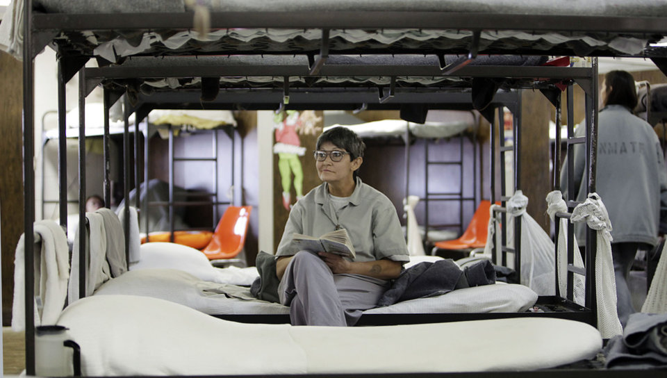 Jo Ann Baker sits on her bunk reading at Eddie Warrior Correctional Center Dec. 1, 2010. MIKE SIMONS/Tulsa World