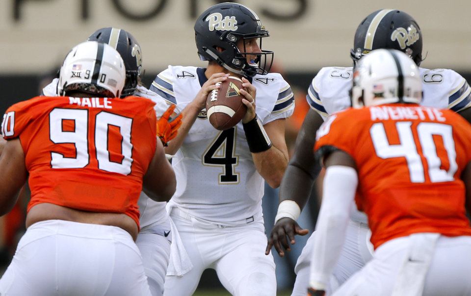 Photo - Pittsburgh's Nathan Peterman (4) looks to throw the ball during a college football game between the Oklahoma State Cowboys (OSU) and the Pitt Panthers at Boone Pickens Stadium in Stillwater, Okla., Saturday, Sept. 17, 2016. Photo by Chris Landsberger, The Oklahoman