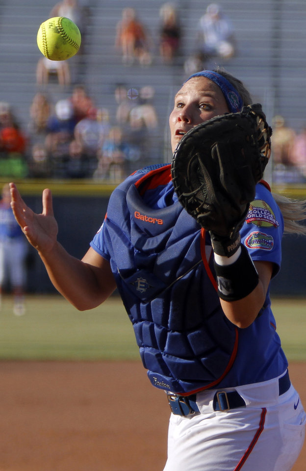 Photo - Florida's Tiffany DeFelice (28) catches a foul ball during the Women's College World Series game between Florida and Alabama at the ASA Hall of Fame Stadium in Oklahoma City, Sunday, June 5, 2011. Photo by Sarah Phipps, The Oklahoman