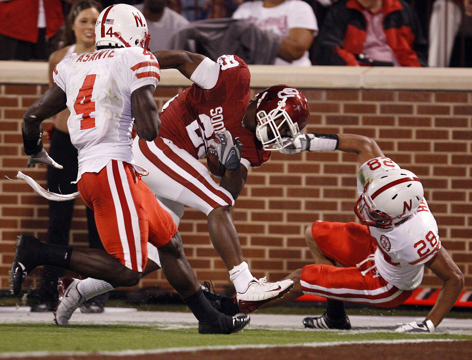 Oklahoma's Chris Brown (29) is pulled down by Nebraska's Eric Hagg (28) during the first half of the college football game between the University of Oklahoma Sooners (OU) and the University of Nebraska Huskers (NU) at the Gaylord Family-Oklahoma Memorial Stadium, on Saturday, Nov. 1, 2008, in Norman, Okla. 