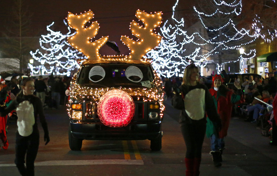 Photo - A car decorated with lights drives down the street during the Edmond Electric Parade of Lights in downtown Edmond, Okla., Saturday, Dec. 8, 2012. Photo by Bryan Terry, The Oklahoman