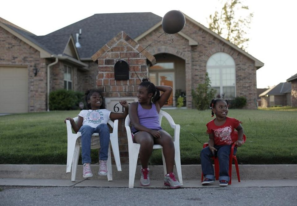 Brianna Young, 9, Evelyn Floyd, 9, and Brijan'e Young, 4, sit together during a National Night Out event at the JFK Neighborhood in Oklahoma City, Tuesday, Sept. 11, 2012.  Photo by Garett Fisbeck, The Oklahoman