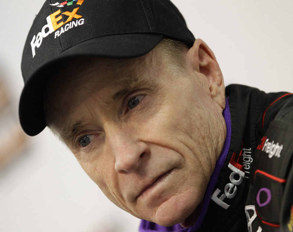Photo - Driver Mark Martin listens to a question during a press conference at Martinsville Speedway in Martinsville, Va.  Friday April 5, 2013. Martin will drive for the injured Denny Hamlin in Sunday's NASCAR Sprint Cup series race.   (AP Photo/Steve Helber)