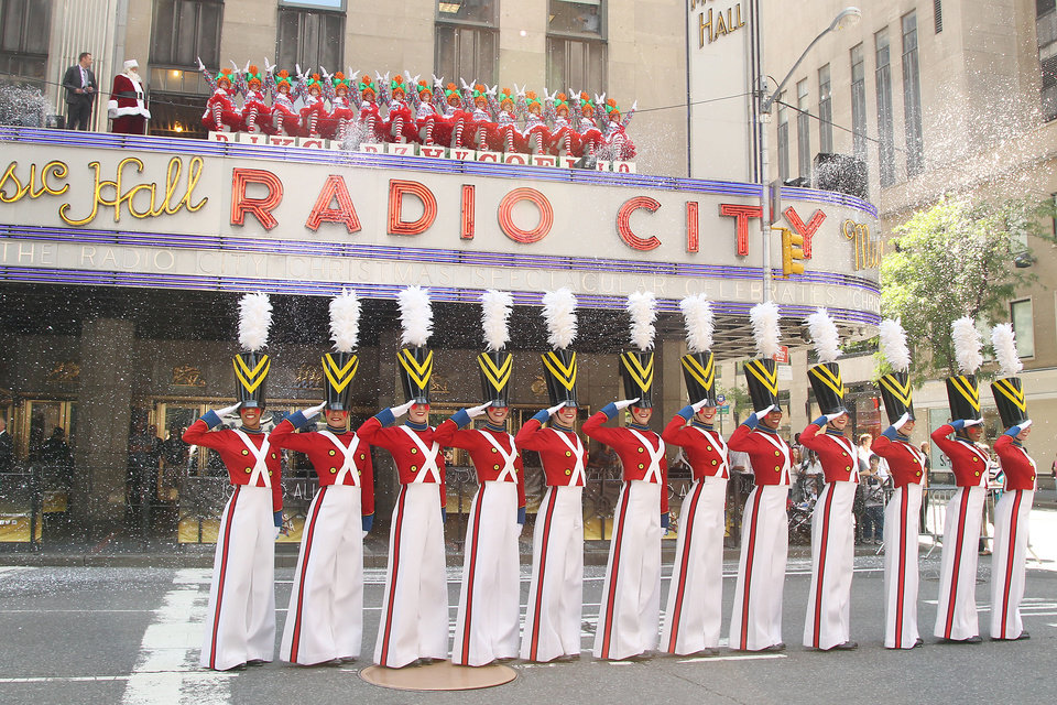 """Photo - This image released by Starpix shows The Rockettes dressed as toy soldiers and rag dolls at Radio City Music Hall in New York, Thursday, Aug. 14, 2014, kicking off the 2014 """"The Radio City Christmas Spectacular,"""" which starts Nov. 7. (AP Photo/Starpix, Dave Allocca)"""