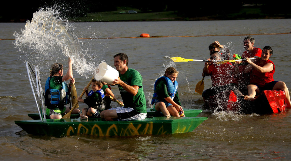 Photo -  Stuart Jackson with the Crocness Monster team flings water at other boats as the team takes part in its sixth Cardboard Boat Regatta. PHOTO BY BRYAN TERRY, THE OKLAHOMAN   Bryan Terry -  THE OKLAHOMAN