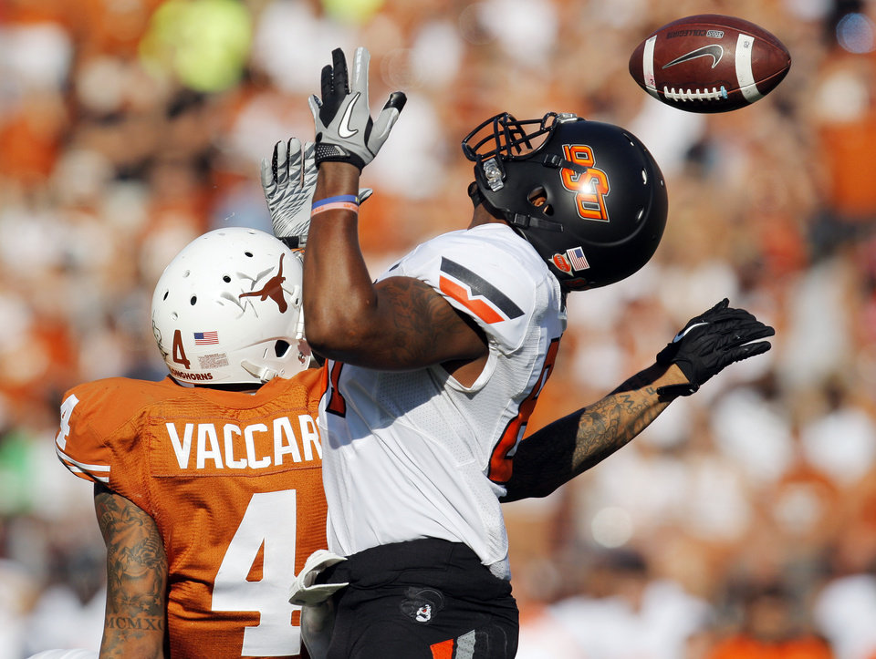 Photo - Texas' Kenny Vaccaro (4) breaks up a pass intended for Oklahoma State's Tracy Moore (87) in the third quarter during a college football game between the Oklahoma State University Cowboys (OSU) and the University of Texas Longhorns (UT) at Darrell K Royal-Texas Memorial Stadium in Austin, Texas, Saturday, Oct. 15, 2011. OSU won, 38-26. Photo by Nate Billings, The Oklahoman