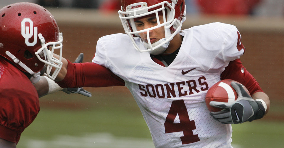 Photo - COLLEGE FOOTBALL / RED AND WHITE SPRING GAME: Javon Harris (left) tackles Kenny Stills (4) during the spring Red and White football game for the University of Oklahoma (OU) Sooners at Gaylord Family -- Oklahoma Memorial Stadium on Saturday, April 17, 2010, in Norman, Okla.  Photo by Steve Sisney, The Oklahoman ORG XMIT: KOD