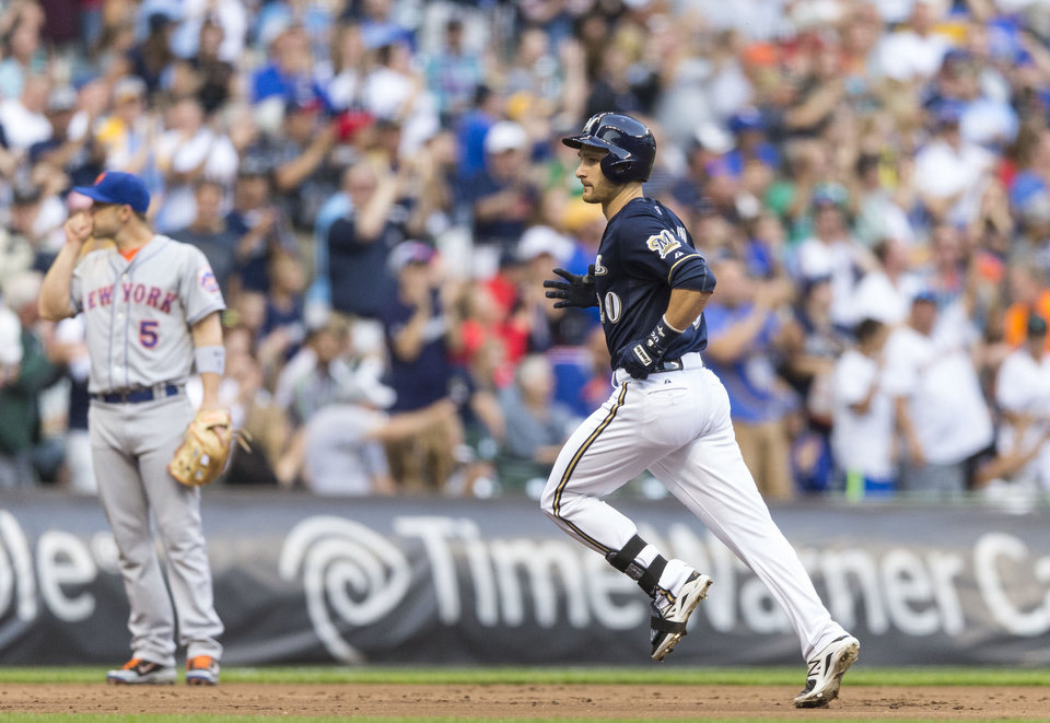 Photo - Milwaukee Brewers' Jonathan Lucroy rounds the bases after hitting a solo home run off of New York Mets' Dillon Gee during the first inning of a baseball game Thursday, July 24, 2014, in Milwaukee. (AP Photo/Tom Lynn)
