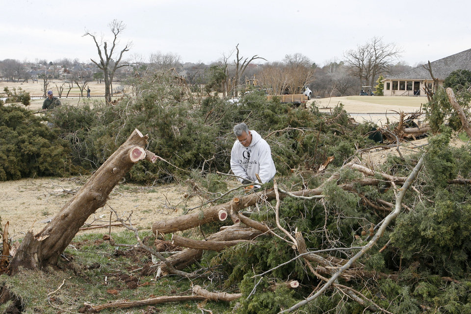 Photo - Crews work to clean up debris left by the tornado at Oak Tree Golf and Country Club in Edmond, OK, Thursday, Feb. 12, 2009. BY PAUL HELLSTERN, THE OKLAHOMAN