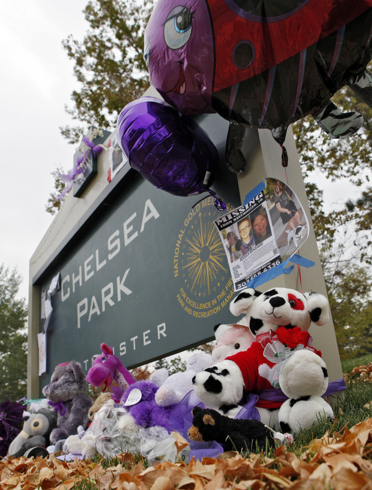 Photo -   A sign to Chelsea Park is adorned with stuffed animals and balloons near the home of missing 10-year-old Jessica Ridgeway in Westminster, Colo., on Friday, Oct. 12, 2012. Police discovered a body in a field six miles away but have yet to identify the remains. Jessica Ridgeway went missing on Friday, Oct. 5 after she left her home on her way to school. (AP Photo/Ed Andrieski)