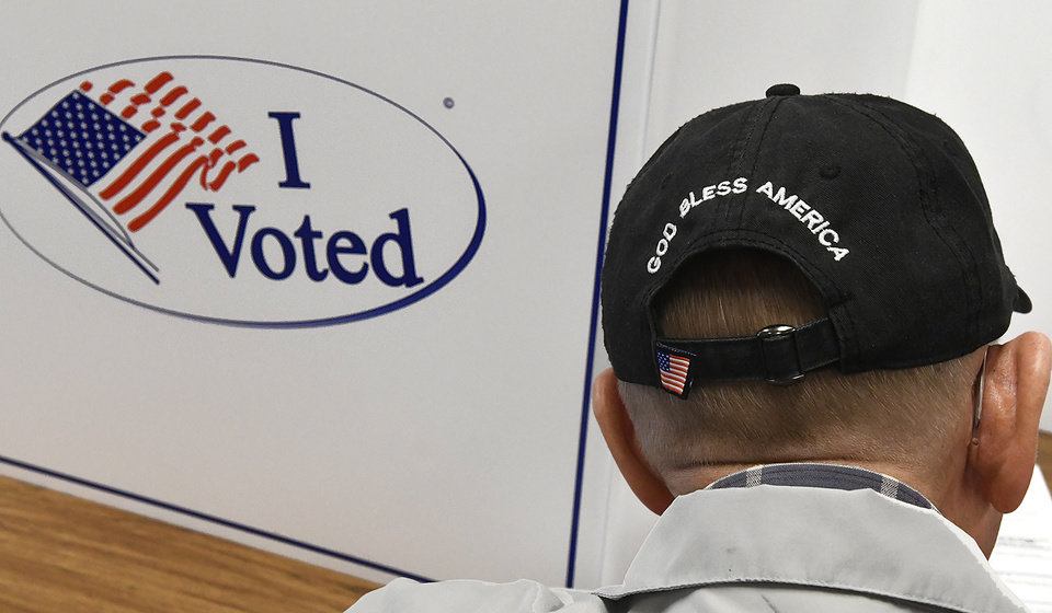 Photo - Gary Pekrul takes advantage of early voting at the Garfield County Election Board Thursday Nov. 1, 2018 in Enid, Okla. (Billy Hefton/The Enid News & Eagle via AP)