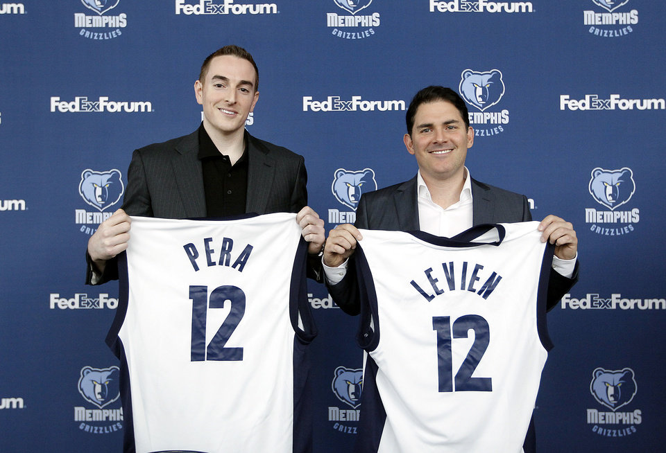 Memphis Grizzlies new chairman Robert J. Pera, left, and new chief executive officer Jason Levien smile during a press conference in Memphis, Tenn., Monday, Nov. 5, 2012. (AP Photo/Lance Murphey)