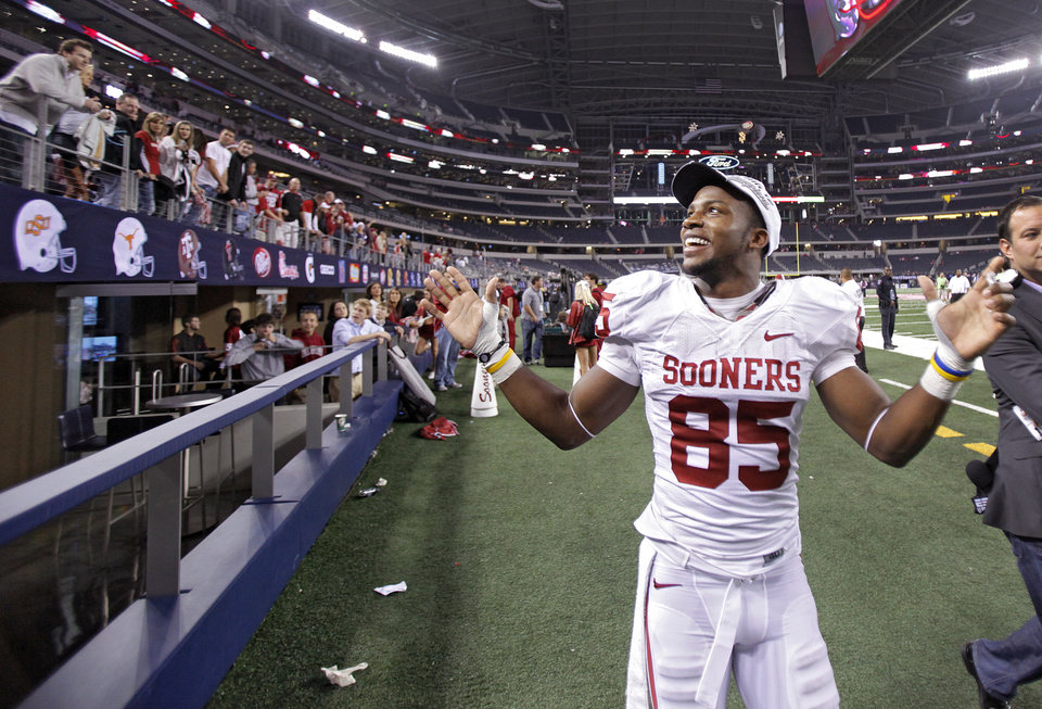 Ryan Broyles (85) celebrates with fans after the win in the Big 12 football championship game between the University of Oklahoma Sooners (OU) and the University of Nebraska Cornhuskers (NU) at Cowboys Stadium on Saturday, Dec. 4, 2010, in Arlington, Texas.  Photo by Chris Landsberger, The Oklahoman