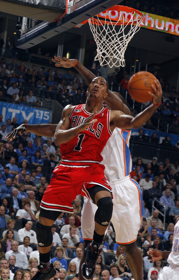 Photo - Chicago's Derrick Rose shoots during the NBA season opener basketball game between the Oklahoma City Thunder and the Chicago Bulls in the Oklahoma City Arena on Wednesday, Oct. 27, 2010. Photo by Sarah Phipps, The Oklahoman