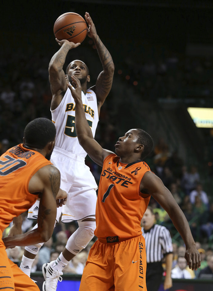 Baylor\'s Pierre Jackson (55) shoots over Oklahoma State\'s Michael Cobbins, left, and Kirby Gardner during the second half of an NCAA college basketball game, Monday, Jan. 21, 2013, in Waco, Texas. Baylor won 64-54. (AP Photo/Waco Tribune Herald, Rod Aydelotte) ORG XMIT: TXWAC108