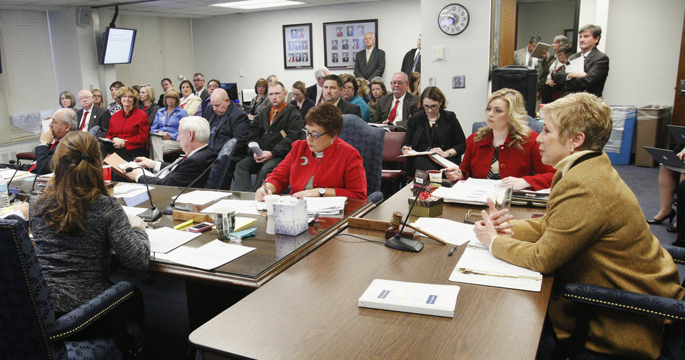 State schools Superintendent Janet Barresi, at right, during a state Board of Education meeting in Oklahoma City Wednesday, Dec. 19, 2012. Photo by Paul B. Southerland, The Oklahoman