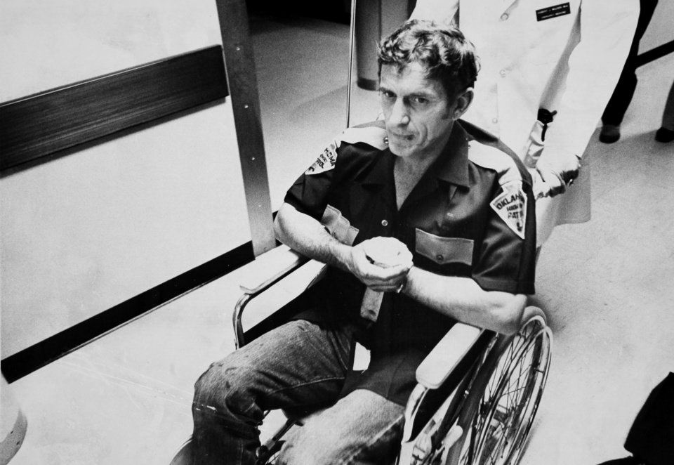 Photo - Oklahoma Highway Patrol Lt. Hoyt Hughes recovers after suffering a shoulder wound in a gun battle with two escapees from the Oklahoma State Penitentiary in Caddo on May 26, 1978. Three troopers were killed in the shootout, including Hughes' partner, Lt. Pat Grimes.  Photo by J. Don Cook, The Oklahoman. Copy of a print from The Oklahoman Archive, Tuesday, Dec. 6, 2011.