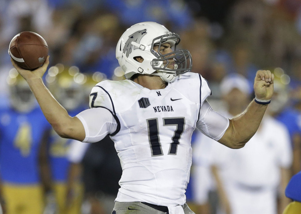 Nevada quarterback Cody Fajardo throws against UCLA during the first half of an NCAA college football game in Pasadena, Calif., Saturday, Aug. 31, 2013. (AP Photo/Chris Carlson)