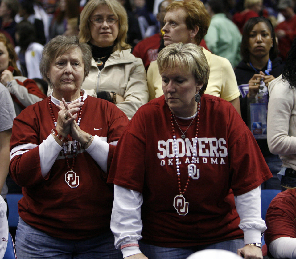 Photo - Stunned fans remain in the stands after the University of Oklahoma is defeated by Louisville 61-59 at the 2009 NCAA women's basketball tournament Final Four in the Scottrade Center in Saint Louis, Missouri on Sunday, April 5, 2009. 