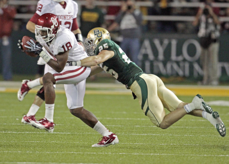 Photo - Oklahoma's Kameel Jackson (18) runs after a catch during the college football game between the University of Oklahoma Sooners (OU) and the Baylor Bears (BU) at Floyd Casey Stadium on Saturday, Nov. 19, 2011, in Waco, Texas.   Photo by Steve Sisney, The Oklahoman