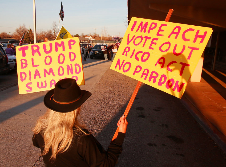 Photo - Leo Luna holds signs outside of the rally during an Elizabeth Warren campaign stop in Oklahoma City at Northwest Classen High School, her alma mater, Sunday, December 22, 2019. [Photo by Doug Hoke/The Oklahoman]