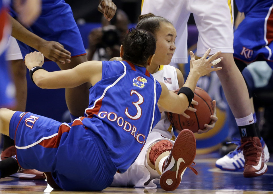 Photo - Kansas' Angel Goodrich (3) and Iowa State' Nicole (Kidd) Blaskowsky (15) scramble on the ground for a loose ball in the first half of an NCAA college basketball game in the Big 12 women's tournament Saturday, March 9, 2013, in Dallas. (AP Photo/Tony Gutierrez)