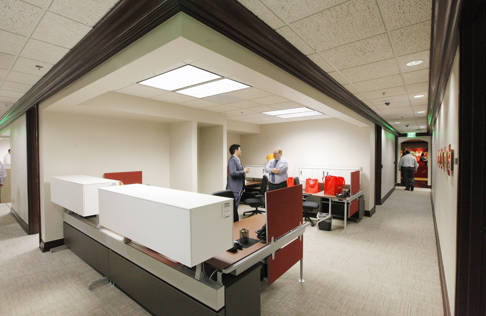 Photo -  This is the hoteling section for employees at the PcW office at Leadership Square. It supports unassigned seating in an office environment to allow for flexibility of use. PHOTO BY PAUL B. SOUTHERLAND, THE OKLAHOMAN    PAUL B. SOUTHERLAND -