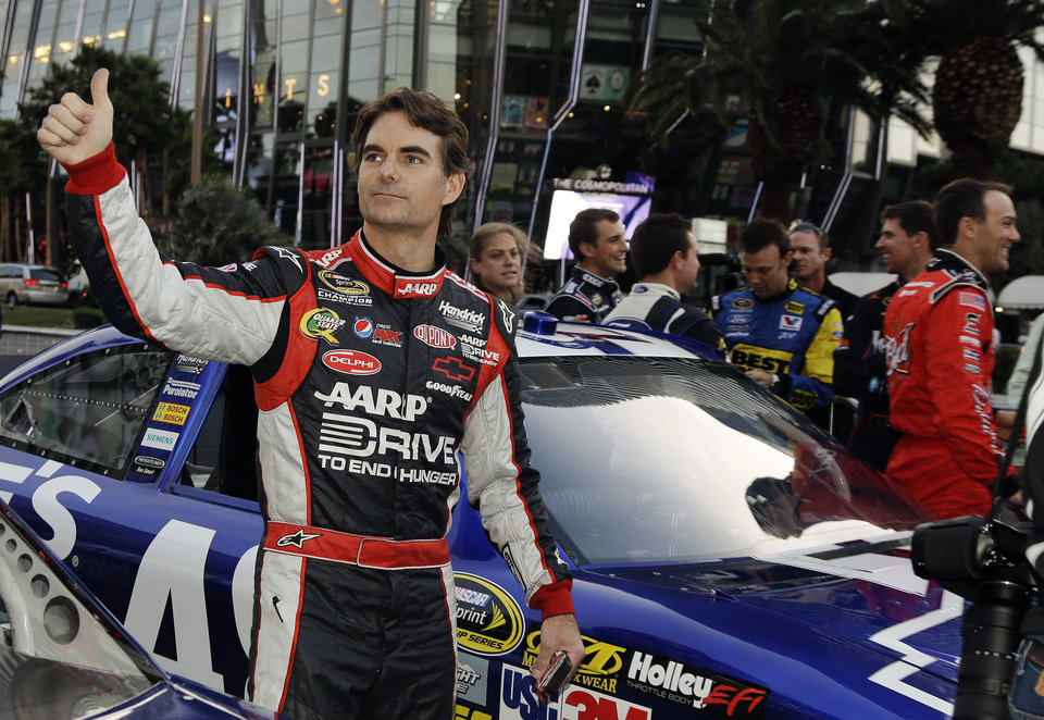 Photo - Jeff Gordon waves to fans after driving down the Las Vegas Strip for the Nascar Awards Week victory lap, Thursday, Nov. 29, 2012, in Las Vegas. (AP Photo/Julie Jacobson)