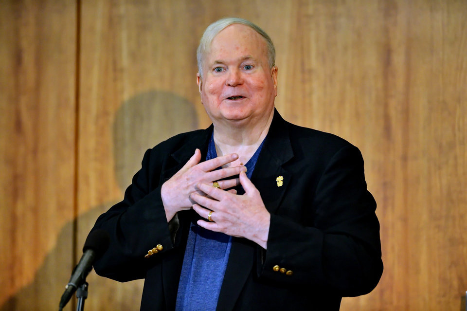 Photo - REMOVES REFERENCE TO COLLECTION DONATED - Author Pat Conroy speaks to a crowd during a ceremony Friday, May 16, 2014 at the Hollings Library in Columbia, S.C. in which Conroy announced that his collection of handwritten manuscripts, personal papers and family memorabilia will go to the University of South Carolina. Dean of University Libraries Tom McNally said the archive was acquired for the university through a donation made by USC alum Richard Smith and his wife Novelle in memory of Richard's mother Dorothy. (AP Photo/ Richard Shiro)