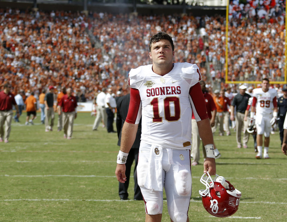 OU's Blake Bell (10) walks off the field after the Red River Rivalry college football game between the University of Oklahoma Sooners and the University of Texas Longhorns at the Cotton Bowl Stadium in Dallas, Saturday, Oct. 12, 2013. Texas won 36-20. Photo by Bryan Terry, The Oklahoman