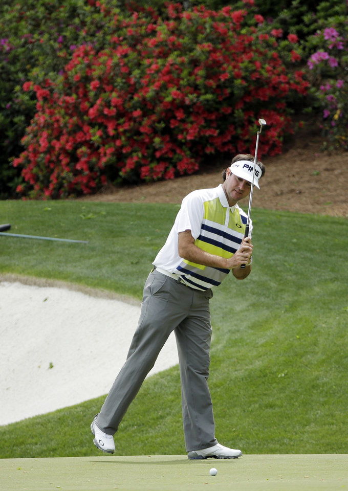 Photo - Bubba Watson watches as he misses an eagle putt on the 13th green during the second round of the Masters golf tournament Friday, April 11, 2014, in Augusta, Ga. (AP Photo/David J. Phillip)