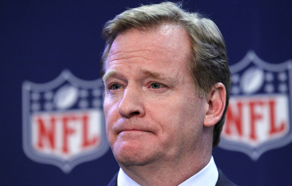 Photo - NFL Commissioner Roger Goodell listens to a question during a news conference after the NFL owners meeting, Wednesday, Dec. 12, 2012, in Irving, Texas. Goodell said he