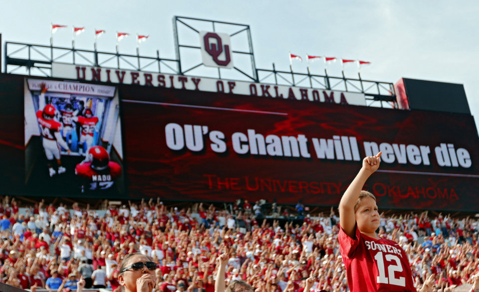 An Oklahoma fans sings along in the school song during the college football game between the University of Oklahoma Sooners (OU) and the University of Tulsa Hurricanes (TU) at the Gaylord-Family Oklahoma Memorial Stadium on Saturday, Sept. 14, 2013 in Norman, Okla.  Photo by Chris Landsberger, The Oklahoman