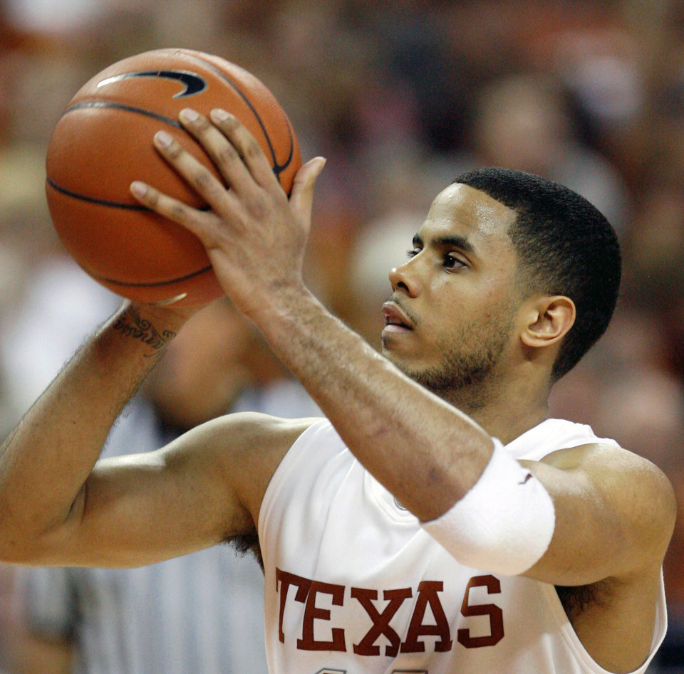 Photo - Texas guard D.J. Augustin works from the free-throw line during second half action in their men's college basketball game against Texas A&M Monday, Feb. 18, 2008, in Austin, Texas. Augustin's game-high 27 points helped Texas win 77-50. (AP Photo/Harry Cabluck) ORG XMIT: TXHC104