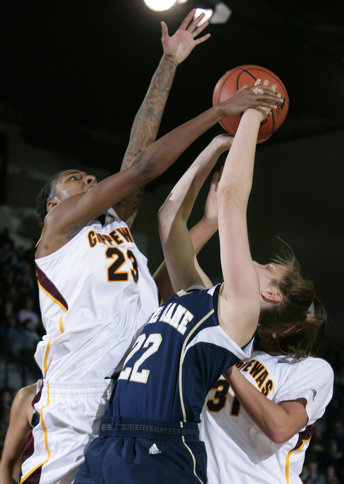 Photo - Central Michigan's Crystal Bradford (23), Notre Dame's Madison Cable (22) and Central Michigan's Jordan LaDuke battle for a rebound during the second half of an NCAA college basketball game on Thursday, Nov. 29, 2012, in Mount Pleasant, Mich. Notre Dame won 72-63. (AP Photo/Al Goldis)