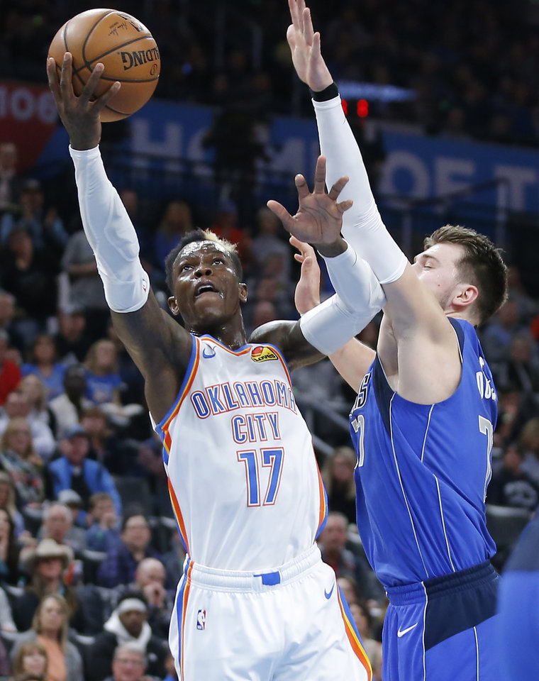 Photo - Oklahoma City's Dennis Schroder (17) goes to the basket beside Luka Doncic (77) of Dallas during an NBA basketball game between the Oklahoma City Thunder and the Dallas Mavericks at Chesapeake Energy Arena in Oklahoma City, Tuesday, Dec. 31, 2019. Oklahoma City won 106-101. [Bryan Terry/The Oklahoman]