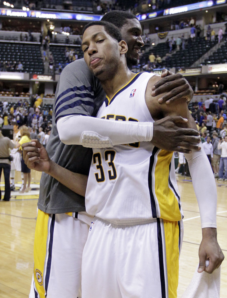 Photo -   Indiana Pacers forward Danny Granger (33) gets a hug from center Roy Hibbert as they leave the court following Game 5 of an NBA basketball first-round playoff series against the Orlando Magic, in Indianapolis on Tuesday, May 8, 2012. The Pacers defeated the Magic 105-87 to win the series 4-1. (AP Photo/Michael Conroy)