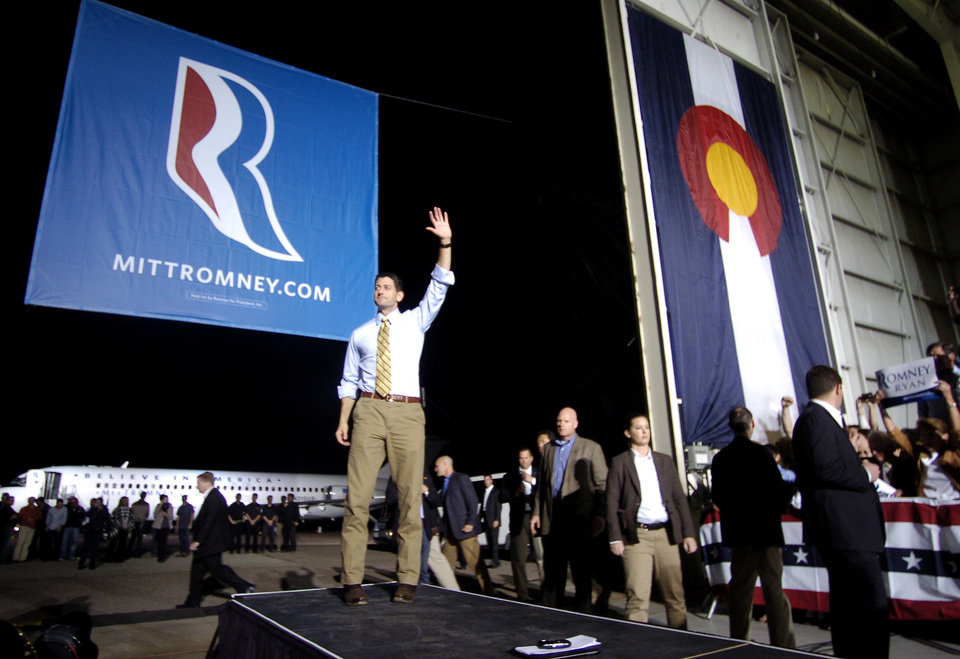 Photo -   Republican vice presidential candidate, U.S. Rep. Paul Ryan, R-Wis., waves goodbye to hundreds of supporters at the Colorado Jet Center in Colorado Springs, Colo. on Sunday, Oct. 21, 2012 during a campaign stop. (AP Photo/Bryan Oller)