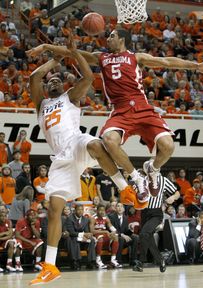 Photo - Oklahoma's C.J. Washington (5) fouls Oklahoma State's Darrell Williams (25) during the Bedlam men's college basketball game between the University of Oklahoma Sooners and Oklahoma State University Cowboys at Gallagher-Iba Arena in Stillwater, Okla., Saturday, February, 5, 2011. Photo by Bryan Terry, The Oklahoman
