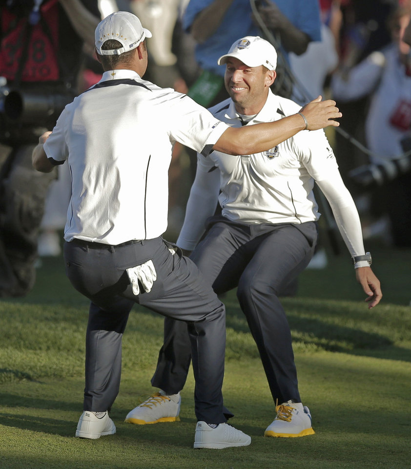 Europe's Sergio Garcia and Martin Kaymer celebrate after winning the Ryder Cup PGA golf tournament Sunday, Sept. 30, 2012, at the Medinah Country Club in Medinah, Ill. (AP Photo/Charlie Riedel)  ORG XMIT: PGA194