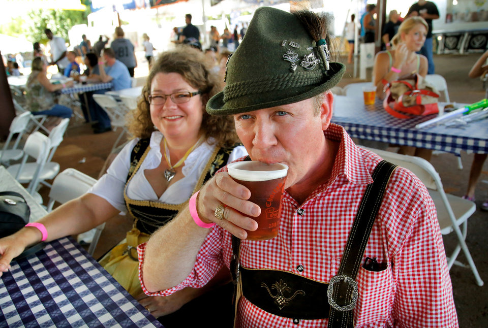 Photo -  Mike Wilson takes the first sip of a Paulaner Oktoberfest beer at the Choctaw Oktoberfest on Saturday, Sep. 5, 2015. Wilson and his family came up to enjoy the annual celebration in Choctaw from their home in Lewisville, TX. He said it was his first visit to the festival. Photo by Jim Beckel, The Oklahoman.