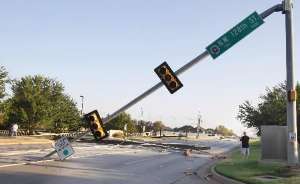 Photo - Street signals and power lines down along Rockwell Ave. at NW 128 Street, the entrance to Francis Tuttle in Oklahoma City Tuesday, Aug. 9, 2011. A thunderstorm moved through the area Monday evening causing storm damage. Photo by Paul B. Southerland