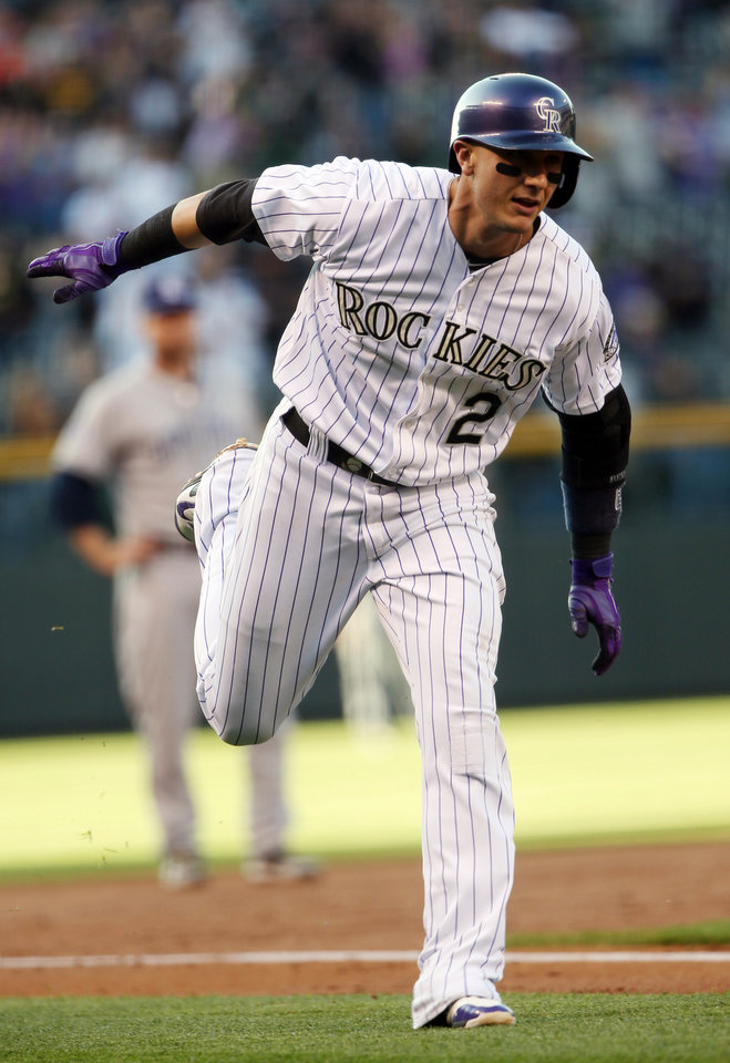 Photo - Colorado Rockies' Troy Tulowitzki circles the bases after hitting a solo home run against the San Diego Padres in the first inning of a baseball game in Denver on Saturday, May 17, 2014. (AP Photo/David Zalubowski)
