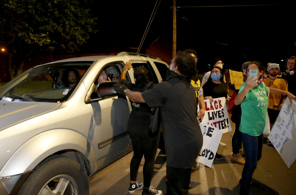 Photo - Protesters argue with a motorist along Pennsylvania Avenue in Oklahoma City, Saturday, May 30, 2020. The protest was in response to the death of George Floyd. [Bryan Terry/The Oklahoman]