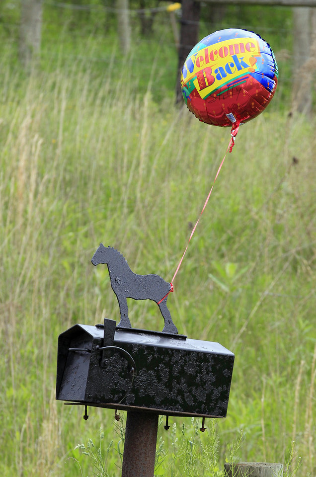 "A ""welcome back"" balloon is tied to the mailbox at the farm of Marian Thompson near Zanesville, Ohio Friday, May 4, 2012. The Columbus Zoo returned five exotic animals to Thompson, the survivors of 56 animals her late husband, Terry Thompson, released from the eastern Ohio farm on Oct. 18, 2011, before he committed suicide. Fearing for the public's safety, authorities killed 48 of the animals. (AP Photo/Mark Duncan)"