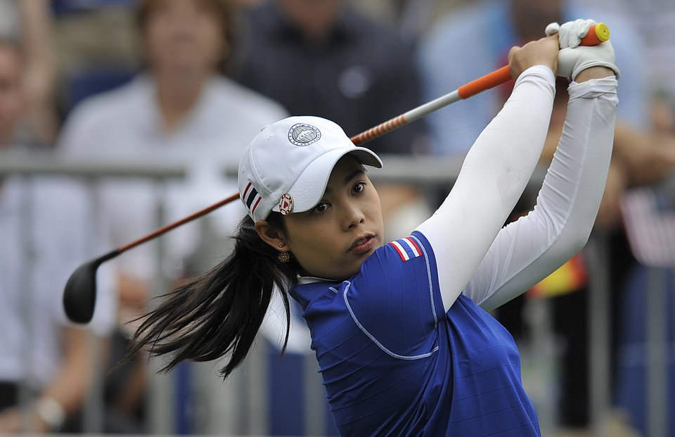 Photo - Moriya Jutanugarn tees off the hole first during the first round of the International Crown LPGA golf tournament Thursday, July 24, 2014, in Owings Mills, Md..(AP Photo/Gail Burton)