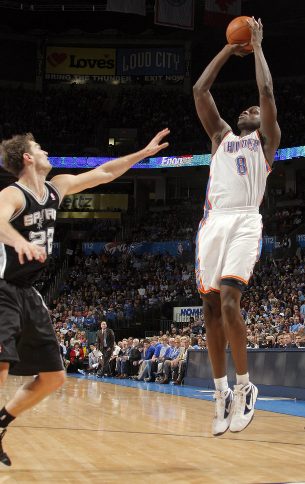 Oklahoma City Thunder\'s Nazr Mohammed (8) shoots over San Antonio Spurs\' Tiago Splitter (22) during the the NBA basketball game between the Oklahoma City Thunder and the San Antonio Spurs at the Chesapeake Energy Arena in Oklahoma City, Sunday, Jan. 8, 2012. Photo by Sarah Phipps, The Oklahoman